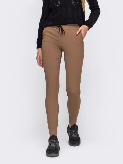 Бежевые брюки зауженного кроя с резинкой по талии 50852, фото 1