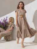Расклешенное платье бежевого цвета с воланом по низу 49369, фото 1